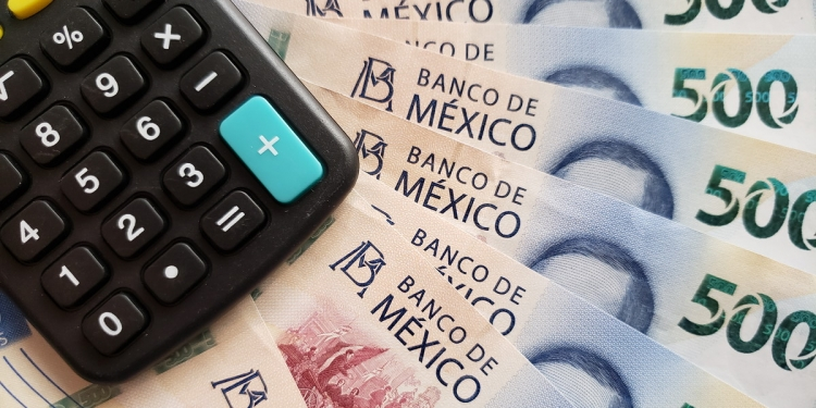 Calculator with Mexican banknotes